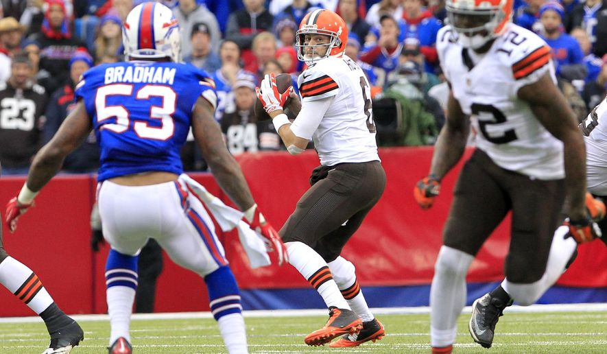 Cleveland Browns quarterback Brian Hoyer, center, looks to pass to wide receiver Josh Gordon, right, during the first half of an NFL football game against the Buffalo Bills, Sunday, Nov. 30, 2014, in Orchard Park, N.Y. The ball was intercepted on the play by strong safety Da'Norris Searcy. (AP Photo/Bill Wippert)