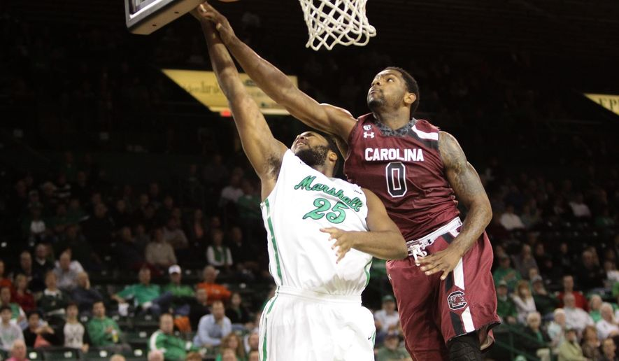 South Carolina's Sindarius Thornwell (0) blocks a shot into the backboard by Marshall's Ryan Taylor (25)during an NCAA college basketball game Monday, Dec. 1, 2014, at the Cam Henderson Center in Huntington, W.Va. (AP Photo/Bishop Nash/The Herald-Dispatch)