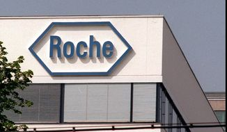 Switzerland is home to two of the world's biggest pharmaceutical companies, Roche and Novartis, but 65 percent of those two firms' employees are not native-born Swiss. (associated press)