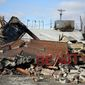 Businesses were left in piles of rubble in the aftermath of violence and looting in Ferguson, Missouri, on the night of Nov. 24, 2014. (Associated Press)