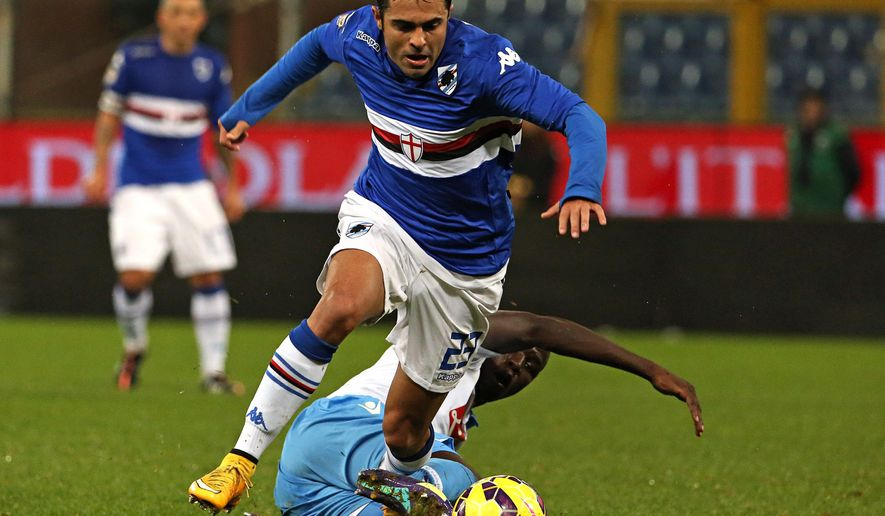 Sampdoria forward Citadin Martins Eder, forward, dribbles past Napoli defender Kalidou Koulibaly during a Serie A soccer match between Sampdoria and Napoli in Genoa, Italy, Monday, Dec. 1, 2014. (AP Photo/Carlo Baroncini)