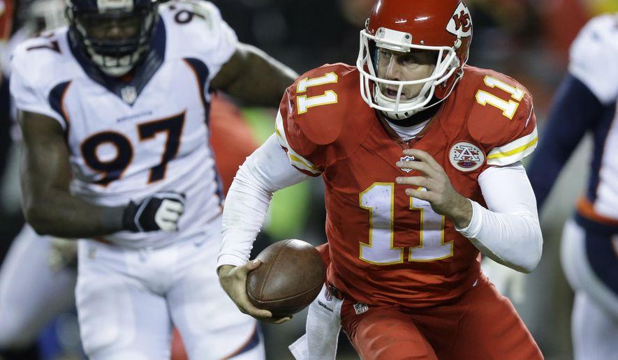 Kansas City Chiefs quarterback Alex Smith (11) runs away from Denver Broncos defensive end Malik Jackson (97) in the second half of an NFL football game in Kansas City, Mo., Sunday, Nov. 30, 2014. (AP Photo/Ed Zurga)