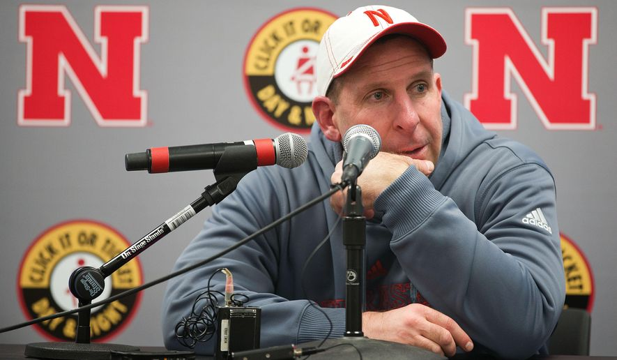 In this Nov. 28, 2014 file photo, Nebraska head coach Bo Pelini answers questions during a news conference after an NCAA college football game against Iowa, in Iowa City, Iowa. Pelini was fired as Nebraska's football coach on Sunday, Nov. 30, after a seven-year stint. (AP Photo/The World-Herald, Ryan Soderlin) MAGS OUT; ALL NEBRASKA LOCAL BROADCAST TELEVISION OUT