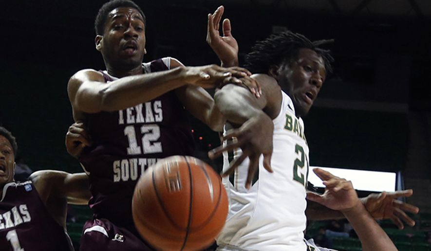 Texas Southern forward Tonnie Collier (12), battles Baylor forward Taurean Prince (21), right, for a loose rebound in the first half of an NCAA college basketball game, Monday, Dec. 1, 2014, in Waco, Texas. (AP Photo/The Waco Tribune-Herald, Rod Aydelotte)