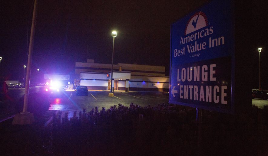 In this Sunday, Nov. 30, 2014 photo, police investigate a triple shooting at Americas Best Value Inn in Buena Vista Township near Saginaw, Mich. Three people were shot during an argument. None of the injuries were life threatening. (AP Photo/The Saginaw News-MLive.com, Coty Giannelli) ALL LOCAL TELEVISION OUT; LOCAL TELEVISION INTERNET OUT