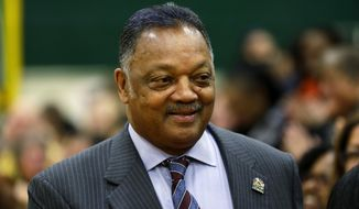 The Rev. Jesse Jackson arrives to talk to students and teachers at an assembly Monday, Dec. 1, 2014, at the Technology Access Foundation Academy in Kent, Wash. (AP Photo/Ted S. Warren) ** FILE **