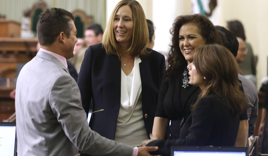 Freshman Assemblywoman Jacqui Irwin,D-Camarillo, second from left, talks with Assembly members  Das Williams, D-Santa Barbara, left, Lorena Gonzalez, D-San Diego, third from left, and Melissa Melendez, R-Lake Elsinore, before the start of the Assembly session in Sacramento, Calif., Monday, Dec.  1, 2014.  Irwin was among the 80 members of the Assembly who were sworn-in to office during ceremonies at the Capitol.(AP Photo/Rich Pedroncelli)