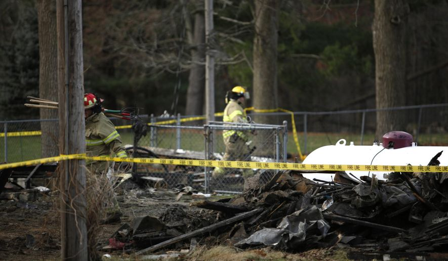 Firefighters with Pavilion Township Fire Department investigate a fatal fire at a home in Kalamazoo County, Mich on Monday, Dec. 1, 2014. Authorities said the body of a man was found following the fire.  (AP Photo/Kalamazoo Gazette-MLive Media Group, Junfu Han ) ALL LOCAL TELEVISION OUT; LOCAL TELEVISION INTERNET OUT
