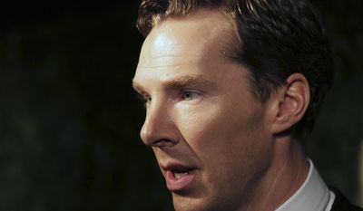 Actor Benedict Cumberbatch talks to the press on arrival at the Evening Standard Theatre Awards in Central London on Nov. 30, 2014. (Grant Pollard/Invision/Associated Press)