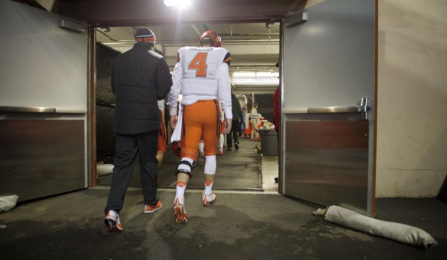 Oregon State quarterback Sean Mannion (4) walks to the locker room after an NCAA college football game against Oregon in Corvallis, Or., Saturday, Nov. 15, 2014. Oregon beat Oregon State 47-19. (AP Photo/Troy Wayrynen)