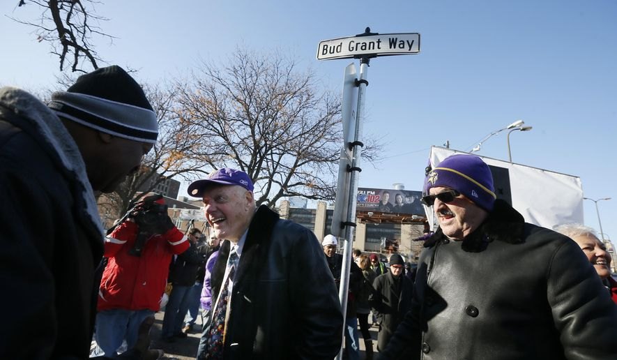 A street was dedicated to honor former Minnesota Vikings head coach Bud Grant, center, on Monday, Dec. 1, 2014 in Minneapolis, Minn.  At right is Vikings owner Zygi Wilf.  The sign was posted at a ceremony Monday featuring Grant, the former Vikings coach who guided the team to four Super Bowls and Pro Football Hall of Fame member. (AP Photo/The Star Tribune, Jerry Holt)