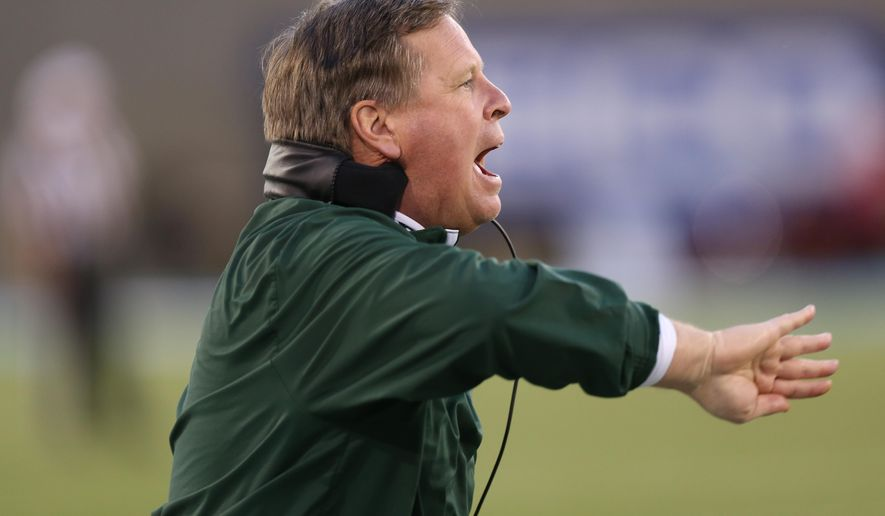 Colorado State head coach Jim McElwain directs his team against Air Force in the fourth quarter of Air Force's 27-24 victory in an NCAA college football game at Air Force Academy, Colo., on Friday, Nov. 28, 2014. (AP Photo/David Zalubowski)