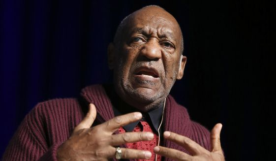 In this Nov. 6, 2013, file photo, comedian Bill Cosby performs at the Stand Up for Heroes event at Madison Square Garden in New York. Cosby resigned Monday, Dec. 1, 2014, as a trustee of Temple University following string of allegations that accused him of drugging and sexually assaulting women over many years. (John Minchillo/Invision/AP, File)