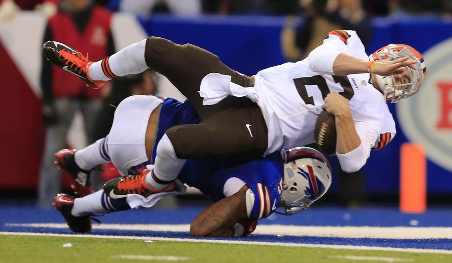 Cleveland Browns quarterback Johnny Manziel (2) scores a touchdown against the Buffalo Bills during the second half at Ralph Wilson Stadium in Orchard Park on Sunday, Nov. 30, 2014. (AP Photo/The Buffalo News, Harry Scull Jr.)