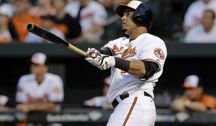 FILE - In this Sept. 4, 2014, file photo, Baltimore Orioles' Nelson Cruz watches his two-run home run in the first inning of an interleague baseball game against the Cincinnati Reds in Baltimore. Two people with knowledge of the deal say the Mariners and free agent slugger Nelson Cruz are nearing agreement on a contact that would give Seattle the right-handed bat it has sought.  The people spoke to The Associated Press on Monday, Dec. 1, 2014, on the condition of anonymity because the deal between Cruz and the Mariners had not been finalized and was pending a physical. (AP Photo/Patrick Semansky, File)