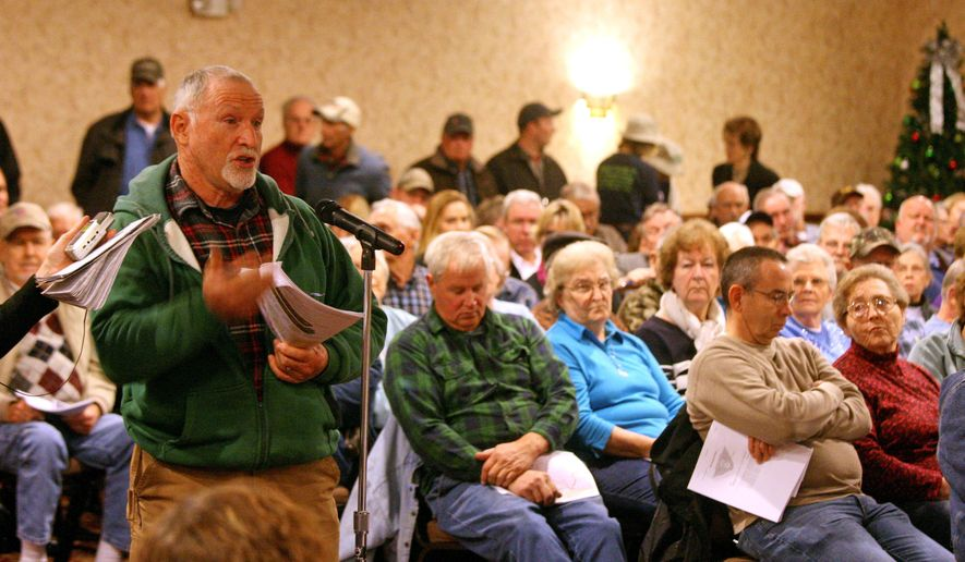 Victor Conlee, who lives in Lee County, asks a question about shut off valves for the Dakota Access Pipeline project at an informational meeting on the $3.78 billion project that will cross through parts of southeast Iowa Monday Dec. 1, 2014 in Fort Madison, Iowa. The pipeline will run 1,134-mile from the Bakken oil fields in North Dakota to Patoka, Ill. (AP Photo/The Hawk Eye, John Gaines)