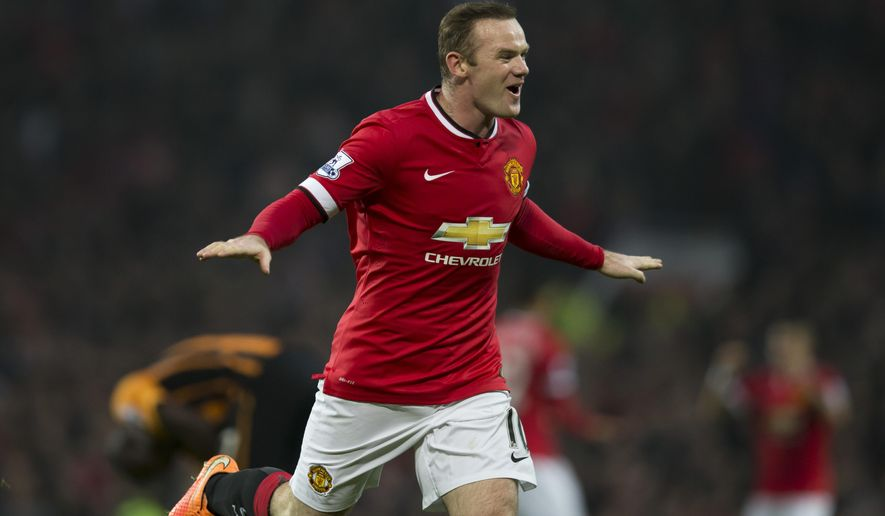 Manchester United's Wayne Rooney celebrates after scoring during the English Premier League soccer match between Manchester United and Hull City at Old Trafford Stadium, Manchester, England, Saturday Nov. 29, 2014. (AP Photo/Jon Super)