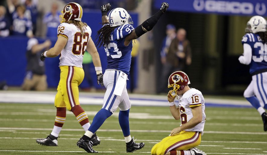 Indianapolis Colts outside linebacker Erik Walden (93) celebrates a Colts touchdown on a fumble by Washington Redskins quarterback Colt McCoy, right, during the second half of an NFL football game Sunday, Nov. 30, 2014, in Indianapolis. (AP Photo/Darron Cummings)