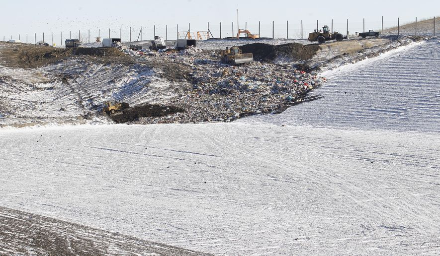 "In this Tuesday, Nov. 25, 2014 photo, the Black Hawk County Landfill is seen in Waterloo, Iowa. The landfill just opened 17 acres of space with a new ""cell"" as the old cell was full and this was causing the landfill to shut down on windy days when trash would blow off the top. (AP Photo/Waterloo Courier, Brandon Pollock)"