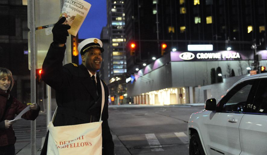Detroit fire Chief Dale Bradley sells Goodfellows newspapers in Detroit on Monday, Dec. 1, 2014. The Detroit Goodfellows are on the streets to raise money for Christmas gifts for needy children. (AP Photo/Detroit News, David Coates)
