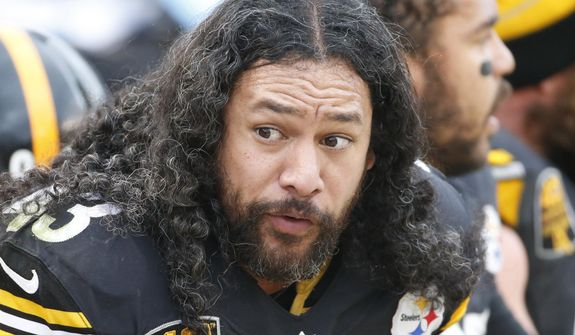 Pittsburgh Steelers strong safety Troy Polamalu (43) sits on the bench in the second quarter of the NFL football game against the New Orleans Saints, Sunday, Nov. 30, 2014 in Pittsburgh. The Saints won 35-32. (AP Photo/Gene J. Puskar)