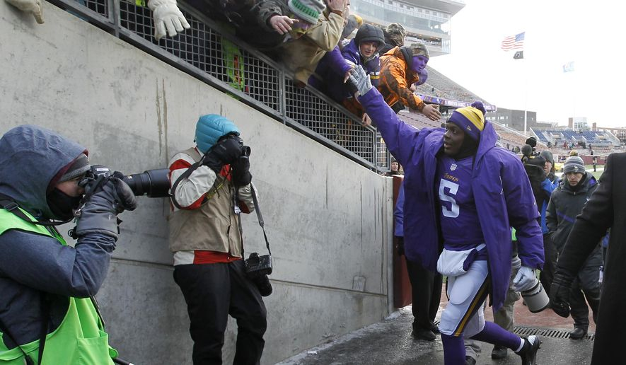 Minnesota Vikings quarterback Teddy Bridgewater celebrates with fans after an NFL football game against the Carolina Panthers, Sunday, Nov. 30, 2014, in Minneapolis. The Vikings won 31-13. (AP Photo/Ann Heisenfelt)