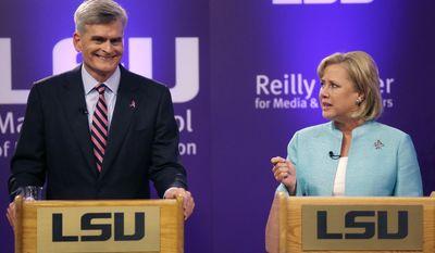 Sen. Mary Landrieu, D-La., and Rep. Bill Cassidy, R-La., participate in a Senate race debate on the LSU campus in Baton Rouge, La., Wednesday, Oct. 29, 2014. (AP Photo/Gerald Herbert)