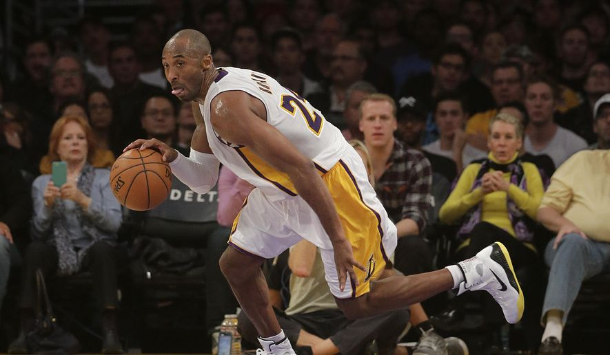 Los Angeles Lakers' Kobe Bryant makes his way down the court during the first half of an NBA basketball game against the Toronto Raptors Sunday, Nov. 30, 2014, in Los Angeles. (AP Photo/Jae C. Hong)