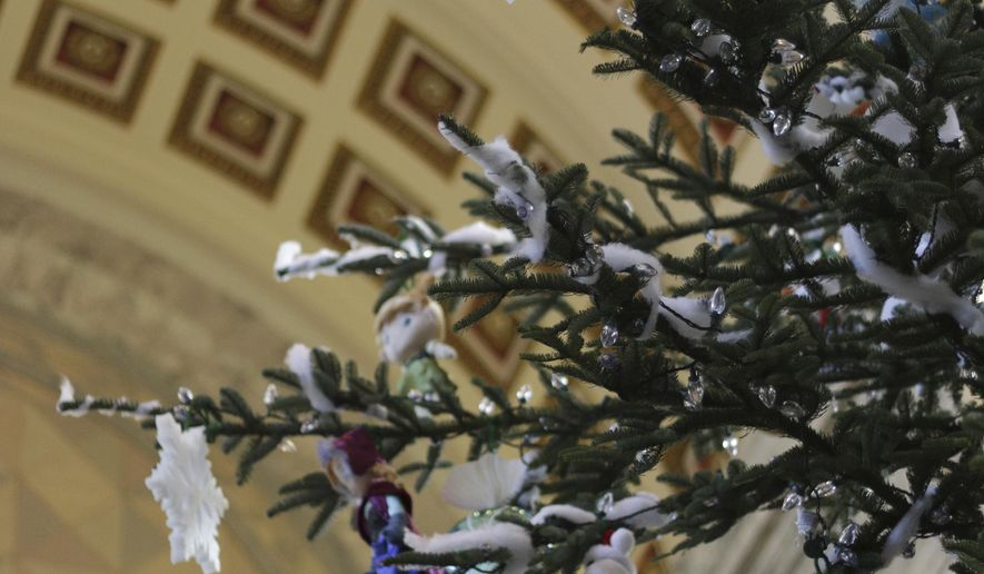 Decorations adorn the state holiday tree in the Capitol Rotunda in Olympia, Wash., on Monday, Dec. 1, 2014. The 35-foot noble fir is from a tree farm in Olympia. (AP Photo/Rachel La Corte)