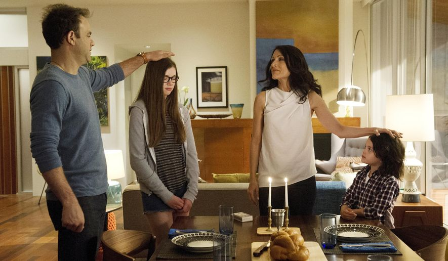 "FILE - This file image provided by Bravo shows Paul Adelstein, from left, Conner Dwelly, Lisa Edelstein, and Dylan Schombing in a scene from ""Girlfriends' Guide to Divorce,"" Bravo's first original scripted series, premiering Dec. 2. (AP Photo/Bravo, Carole Segal, File)"
