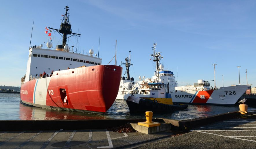 In this Sunday, Nov. 30, 2014 photo provided by the U.S. Coast Guard, the Coast Guard Cutter Polar Star, a 399-foot polar class icebreaker, is escorted away from the pier at its home port of Coast Guard Base Seattle by the tugboat Westrac, for deployment to Antarctica. The crew of Polar Star will be supporting the U.S. Antarctic Program and the National Science Foundation during their four-month mission. (AP Photo/U.S. Coast Guard, Petty Officer 3rd Class Katelyn Shearer)