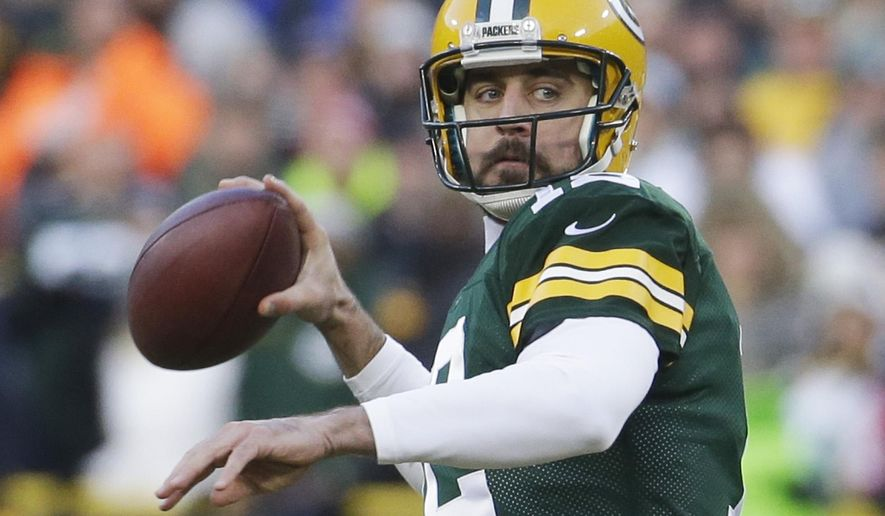 Green Bay Packers' Aaron Rodgers throws during the first half of an NFL football game against the New England Patriots Sunday, Nov. 30, 2014, in Green Bay, Wis. (AP Photo/Morry Gash)
