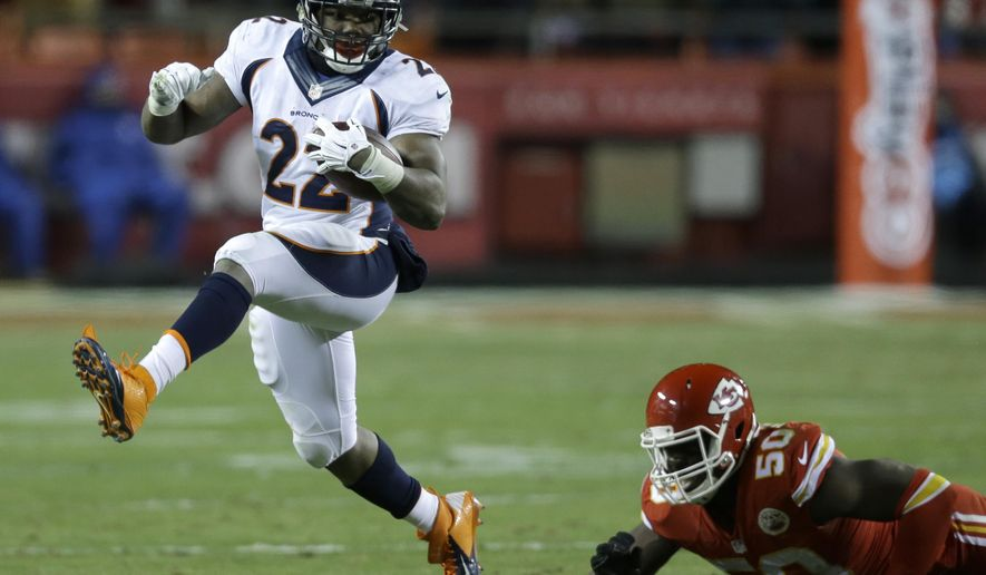 Denver Broncos running back C.J. Anderson (22) runs past Kansas City Chiefs outside linebacker Justin Houston (50) in the first half of an NFL football game in Kansas City, Mo., Sunday, Nov. 30, 2014. (AP Photo/Ed Zurga)