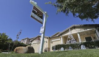 FILE - In this Oct. 27, 2014 file photo, a realty sign is posted in front of a home for sale in Carlsbad, Calif. Real estate data provider CoreLogic reports on October home prices on Tuesday, Dec. 2, 2014. (AP Photo/Lenny Ignelzi, File)