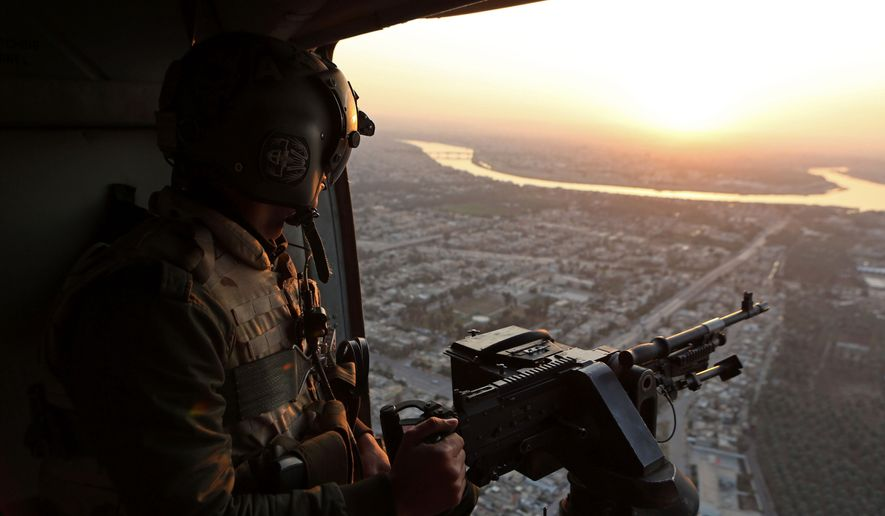An Iraqi soldier secures an area from a helicopter near Baquba, the capital of Iraq's Diyala province, 35 miles (60 kilometers) northeast of Baghdad, Iraq. (Associated Press) ** FILE **
