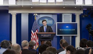 White House press secretary Josh Earnest listens to a question during his daily news briefing at the White House in Washington, Monday, Dec. 1, 2014. Earnest spoke about the president's schedule and answered questions on topics including Ferguson and the economy. (AP Photo/Jacquelyn Martin)