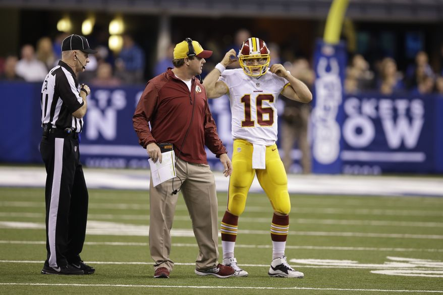 Washington Redskins quarterback Colt McCoy talks with head coach Jay Gruden during the first half of an NFL football game Sunday, Nov. 30, 2014, in Indianapolis. (AP Photo/Darron Cummings)