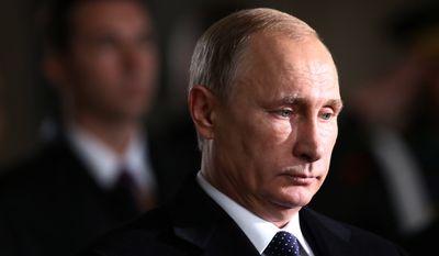 Russian President Vladimir Putin stands for a minute of silence at the mausoleum of modern Turkey's founder Mustafa Kemal Ataturk in Ankara, Turkey, Monday, Dec. 1, 2014. (Associated Press) ** FILE **