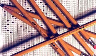 In this undated photo, No. 2 pencils are arranged on a standardized testing bubble answer sheet in Detroit, Mich. Education officials in Michigan are concerned that an increase in testing for high school juniors will lead to problems this spring. Some principals say testing time will nearly be doubled or tripled, from three days of tests to between five and eight days. (AP Photo/Detroit Free Press) MANDATORY CREDIT DETROIT FREE PRESS