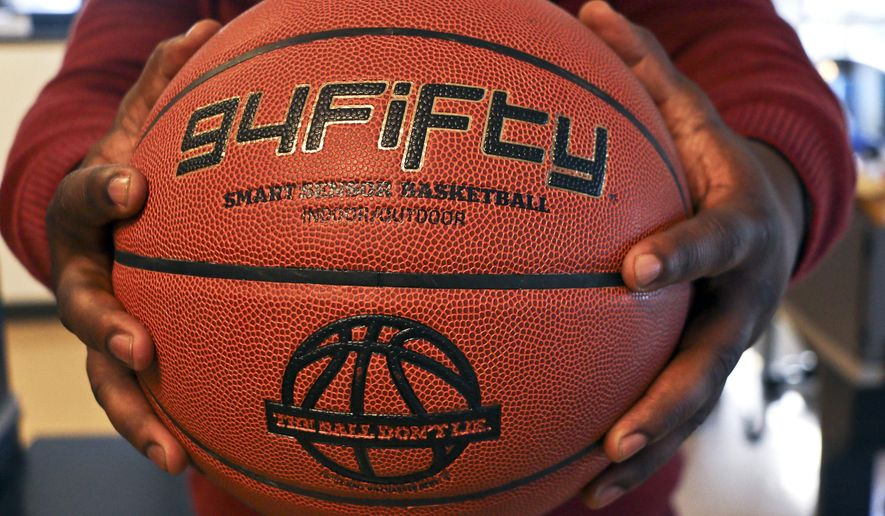 This Sunday, Nov. 30, 2014 photo shows the 94Fifty basketball, in Atlanta. The regulation-size ball contains built-in sensors that measure the speed, arc and rotation of the ball and transmits that information wirelessly to a companion app installed on a smartphone or tablet computer. (AP Photo/Ron Harris)