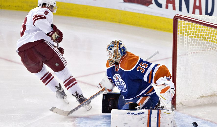 Arizona Coyotes' Tobias Rieder (8) scores a goal against Edmonton Oilers goalie Viktor Fasth (35) during the second period of an NHL hockey game in Edmonton, Alberta, on Monday, Dec. 1, 2014. (AP Photo/The Canadian Press, Jason Franson)
