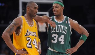 Boston Celtics forward Paul Pierce, right, chats with Los Angeles Lakers guard Kobe Bryant during the final seconds of second half of an NBA basketball game in Los Angeles, Sunday, Jan. 30, 2011. The Celtics won 109-96. (AP Photo/Chris Carlson)