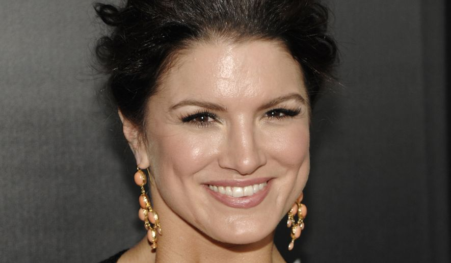 """Actress Gina Carano arrives at the premiere of the feature film """"Haywire"""" in Los Angeles on Thursday, Jan. 5, 2012. (AP Photo/Dan Steinberg)  ** FILE **"""
