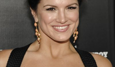"""GINA CARANO - MIXED MARTIAL ARTSActress Gina Carano arrives at the premiere of the feature film """"Haywire"""" in Los Angeles on Thursday, Jan. 5, 2012. (AP Photo/Dan Steinberg)"""