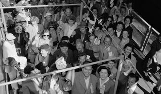 Refugees on the transport Gen. W.C. Langfitt are seen as it docked in New York, July 12, 1955. (AP Photo/Anthony Camerano)