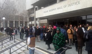 """Frank Murphy Hall of Justice is among many public buildings across the city of Detroit without power Tuesday, Dec. 2, 2014. A """"major cable failure"""" shut down the grid at about 10:30 a.m., and all of the roughly 100 customers on the grid were affected, according to a statement from the City of Detroit. (AP Photo/Detroit Free Press, Elisha Anderson)"""