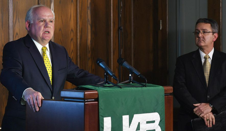 University of Alabama at Birmingham President Ray Watts,left, and UAB Vice President for Financial Affairs and Administration Allen Bolton, right,  address the media during a news conference to discuss the results of their athletics strategic planning process and closing of the UAB football football, rifle, and bowling programs, Tuesday, De. 2, 2014 in Birmingham. Ala. (AP Photo/Tamika Moore, AL.com) MAGS OUT