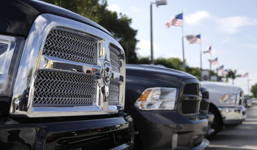 In this Oct. 1, 2014 photo, Dodge Ram trucks are displayed at Planet Dodge, in Miami. Major automakers report sales for November on Tuesday, Dec. 2, 2014. (AP Photo/Lynne Sladky)