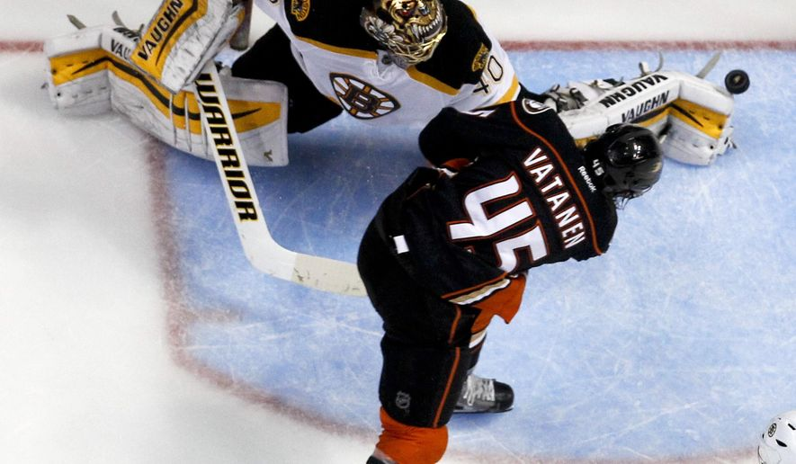Anaheim Ducks defenseman Sami Vatanen, right, scores past Boston Bruins goalie Tuukka Rask during the second period of an NHL hockey game in Anaheim, Calif., Monday, Dec. 1, 2014. (AP Photo/Chris Carlson)