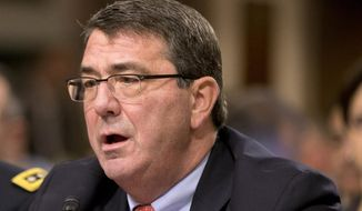 Ashton Carter testifies on Capitol Hill in Washington in this Feb. 12, 2013, file photo. (AP Photo/J. Scott Applewhite, File)